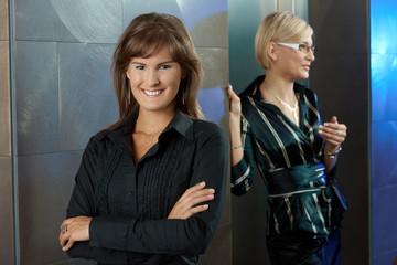 Businesswomen in office lobby
