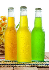 Three cold beverages on wooden table top on white background