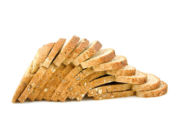 standing slices of bread are falling over white background