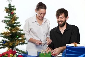 Couple preparing Christmas presents