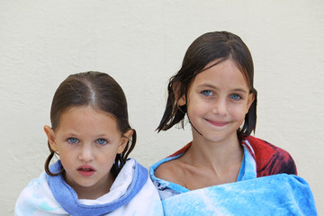 sisters wrapped in a towel