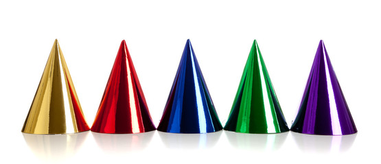 Multi-colored birthday hats on white