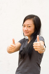 young woman giving two thumbs up