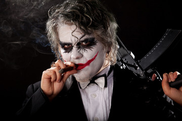 bad joker with submachine gun and cigar