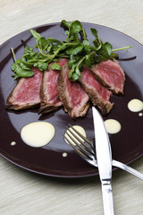 Slices of beef with orange mayonaise sauce