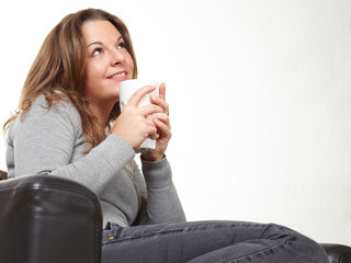 young beauty relaxing and drinking coffee
