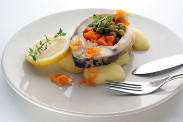 grilled carp fillet with organic vegetable on a plate