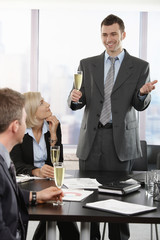 Businessman raising toast with champagne