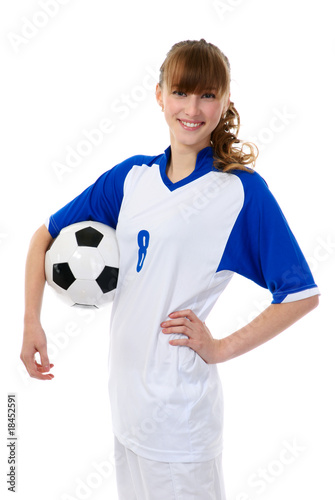 1d8338593 young woman clothed in uniform with soccer ball.