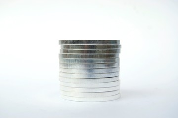 Pile of silver coins isolated on white