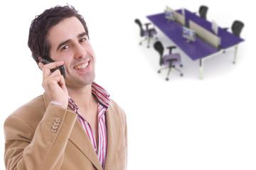 Portrait of happy businessman talking on mobile in office lounge