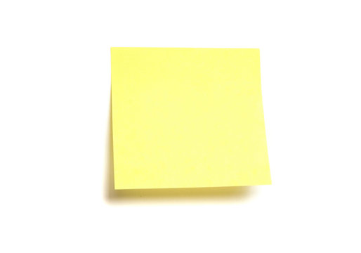 Yellow post-it isolated on white