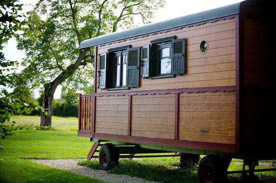 european old caravan on a green field