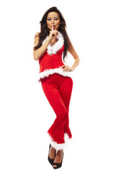 beautiful brunette woman wearing sexy santa claus clothes