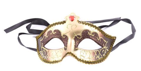 Golden carnival mask on white background