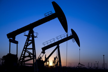 Silhouette of oil pump jacks