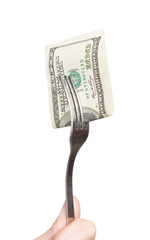 fork with hundred dollar bill close up