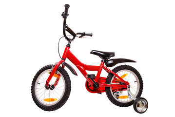 New red children's bicycle on white