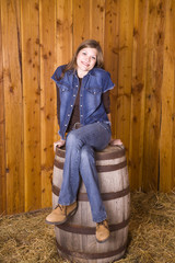 Woman on barrel legs crossed