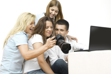young people watching photos on a camera