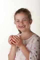 little girl eating red apple