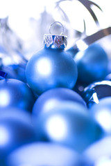 Blue glass Christmas balls on blue  background