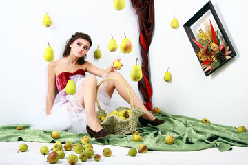 Beautiful girl with a basket of pears, concept autumn