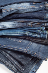 stack of denim blue jeans