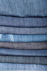 stack of denim blue jeans