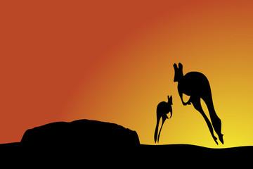 Kangaroos jumping towards Uluru