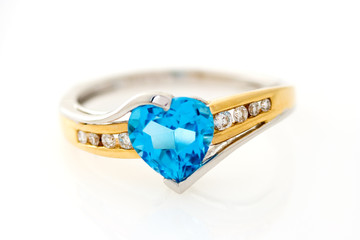 gold ring with blue sapphire heart shaped