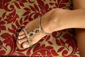 close up shot of a woman foot with elegant clog