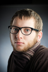 young man in glasses with a beard