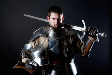 Foto op Canvas Ridders Great knight holding his sword and helmet
