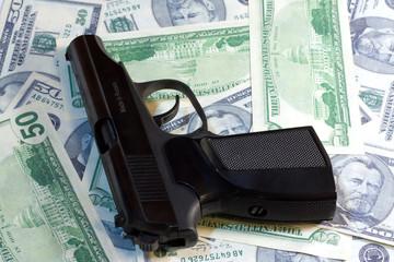 Russian Gun laying on a lot of American Dollars