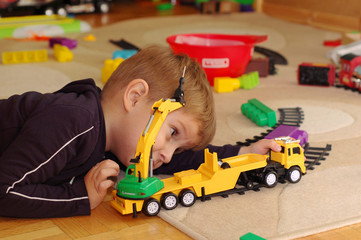 Small boy playing with toy truck
