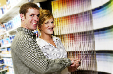 Couple looking at paint samples