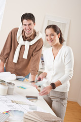 Two interior designer working at office with color swatch