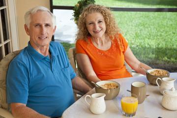 Senior Man and Woman Couple Enjoying a Healthy Breakfast