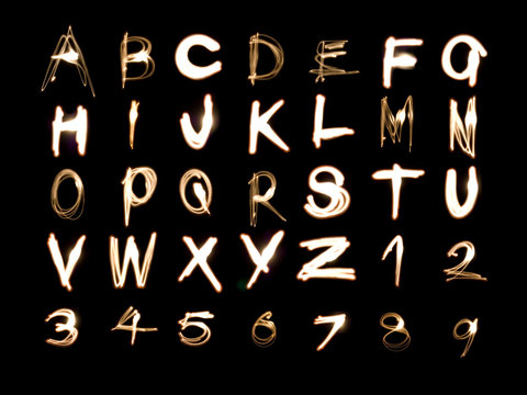 Light painting illustration of the alphabet and numbers 1 to 9