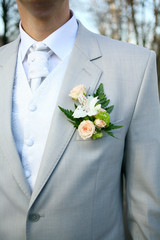 The groom at a wedding ceremony. Boutonniere for jacket