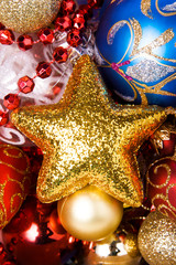 Gold Christmas star with different splendid toys