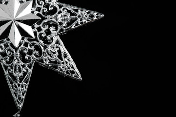 Decorative christmas star - isolated on black background.