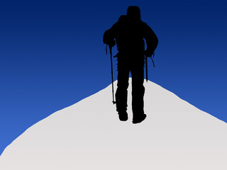 Mountain climber reaching the summit