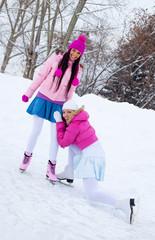 two girls ice skating