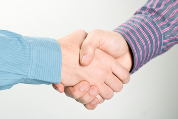 Shaking hands studio shot. Clipping path included.