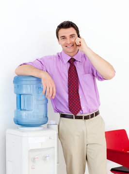 Businessman on phone by the watercooler
