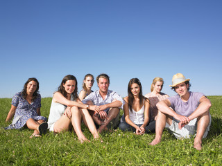 Group of People Sitting on the Grass