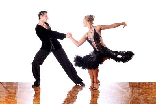 dancers in ballroom against white background