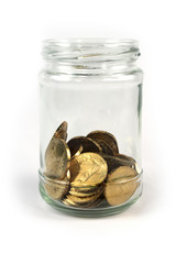 Coins in glass jar isolated